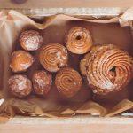 kaboompics.com_Top view of Doughnuts in wooden box